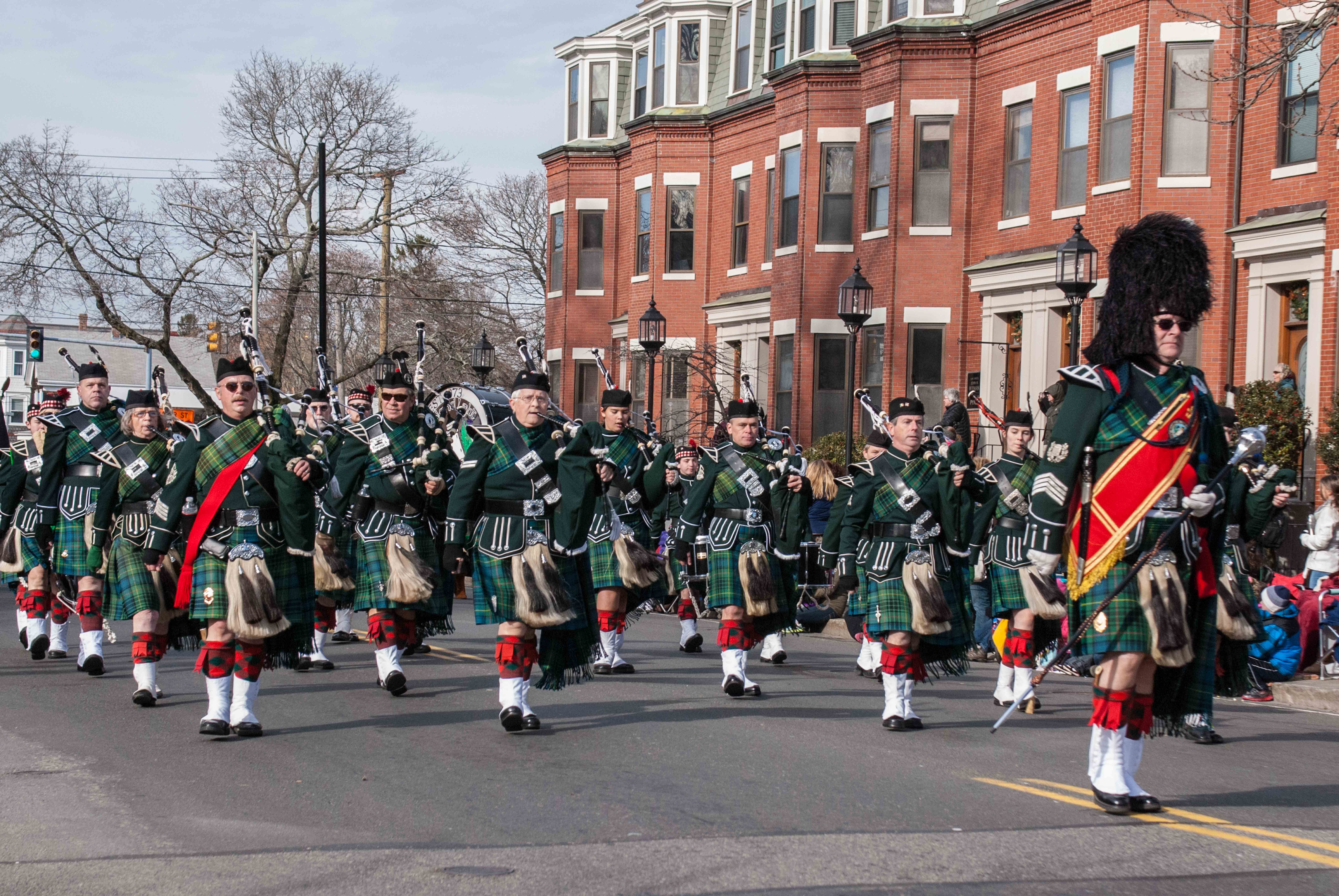 The band wearing the traditional dress uniform of the Highland Light Infantry, marching in the Plymouth Thanksgiving parade.